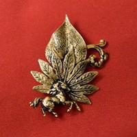 Broche dorée Cheval